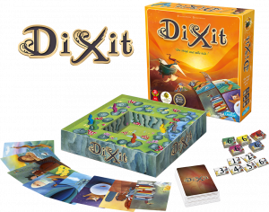 A photo of the contents of the board game Dixit. Large cards showing fanciful illustrations surround  a scoring track designed to look like rabbits hopping along a path.