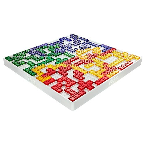 Photo of a game of Blockus in progress. A grooved central board is covered in tetris-like shapes in colours representing four players.