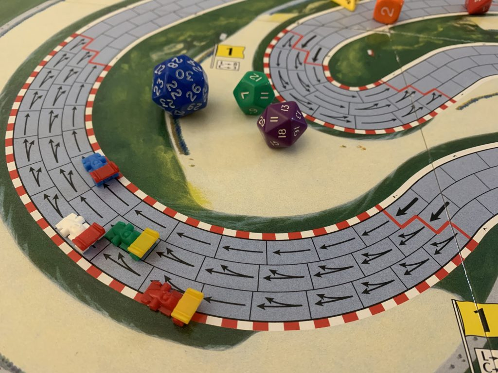 Illustrative photo of part of the racetrack used to play Formula D. Polyhedral dice sit in the bend.